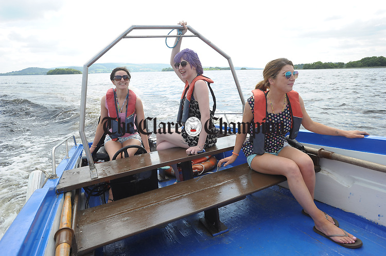 Cousins, Grainne Madden, Rachel Madden and Siobhan Madden on their way back from a trip to Lough Derg on Ger Madden's boat near Mountshannon harbour. Photograph by John Kelly.