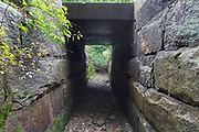Inside a granite culvert along the old Pemigewasset Valley Railroad in Plymouth, New Hampshire. Eventually leased to the Boston & Maine Railroad in 1895, the Pemigewasset Valley Railroad connected Plymouth to North Woodstock. This culvert is located near today's Common Man Inn & Spa.