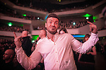 """© Joel Goodman - 07973 332324 . 05/02/2016 . Manchester , UK . Audience member . """" Hacienda Classical """" debut at the Bridgewater Hall . The 70 piece Manchester Camerata and performers including New Order's Peter Hook , Shaun Ryder , Rowetta Idah , Bez and Hacienda DJs Graeme Park and Mike Pickering mixing live compositions . Photo credit : Joel Goodman"""
