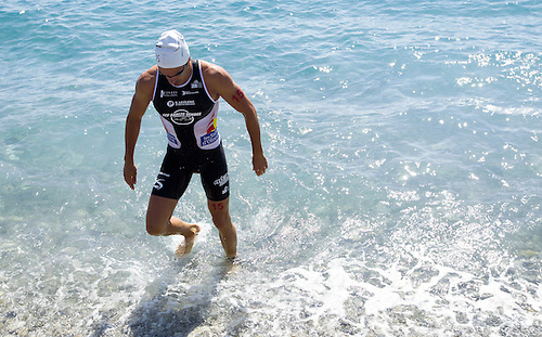16 SEP 2012 - NICE, FRA - Bruno Pais of Les Sables Vendee Triathlon leaves the water after a warm up swim before the start of the French Grand Prix triathlon series final stage held during the Triathlon de Nice Côte d'Azur (PHOTO (C) 2012 NIGEL FARROW)