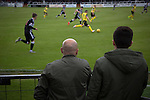 Elgin City 3 Edinburgh City 0, 13/08/2016. Borough Briggs, Scottish League Two. Two spectators in front of the main stand watching the action at Borough Briggs, home to Elgin City, on the day they played SPFL2 newcomers Edinburgh City (in yellow). Elgin City were a former Highland League club who were elected to the Scottish League in 2000, whereas Edinburgh City became the first club to gain promotion to the League by winning the Lowland League title and subsequent play-off matches in 2015-16. This match, Edinburgh City's first away Scottish League match since 1949, ended in a 3-0 defeat, watched by a crowd of 610. Photo by Colin McPherson.