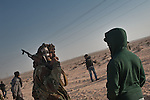 © Remi OCHLIK/IP3 -   Benghazi March 24, 2011 - Opposition fighters hold their position at 9 kilometers from Adjabyia still occupied by the loyalist forces