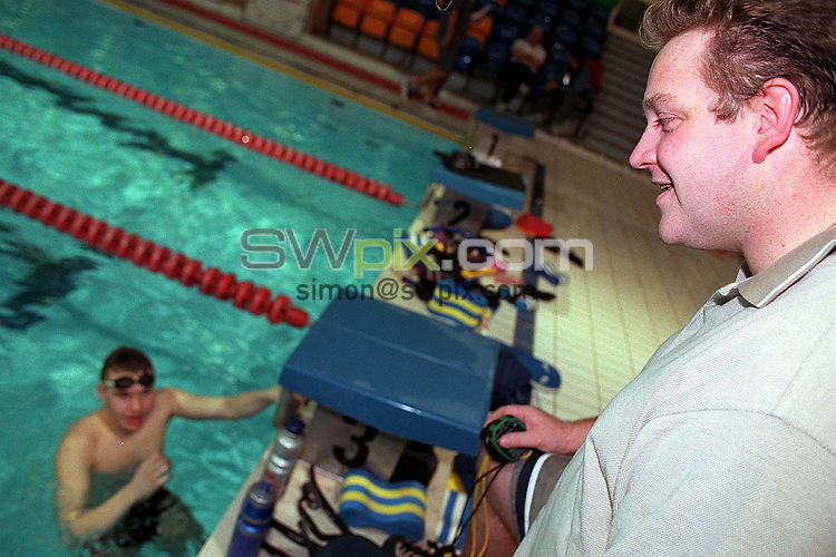 Pix:Ben Duffy/SWpix...World Class Potential Swimming camp(Boys ages 14-17)...23/02/2001..COPYRIGHT PICTURE>>SIMON WILKINSON..John Atkinson(Coaching Director for Youth Swimming) discuss training at the British World Class swimming camp in Bath