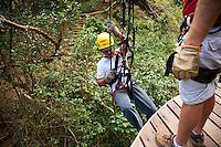 Man repelling with proper gear preparing to go Ziplining on the Big island with Kohala zipline