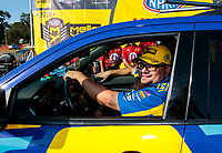 Aug 18, 2019; Brainerd, MN, USA; Crew member for NHRA funny car driver Ron Capps celebrates after winning the Lucas Oil Nationals at Brainerd International Raceway. Mandatory Credit: Mark J. Rebilas-USA TODAY Sports