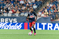 FOXBOROUGH, MA - JULY 7: Maciel #13 of New England Revolution looks to pass during a game between Toronto FC and New England Revolution at Gillette Stadium on July 7, 2021 in Foxborough, Massachusetts.
