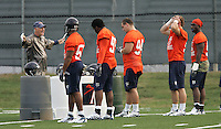 Virginia's head coach Al Groh, left, explains a play to the defensive line during Virginia's 1st practice Friday August 4, 2006 at the University of Virginia in Charlottesville, VA. Photo/The Daily Progress/Andrew Shurtleff