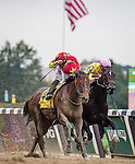 ELMONT, NY - OCTOBER 08: Manuel Franco, atop Yellow Agate #4, celebrating after winning the 69th Running of The Frizette, on Jockey Club Gold Cup Day at Belmont Park on October 8, 2016 in Elmont, New York. (Photo by Douglas DeFelice/Eclipse Sportswire/Getty Images)