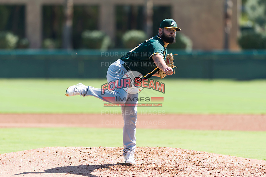 Oakland Athletics relief pitcher Joe DeMers (73) follows through on his delivery during an Instructional League game against the Los Angeles Dodgers at Camelback Ranch on September 27, 2018 in Glendale, Arizona. (Zachary Lucy/Four Seam Images)