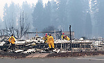 Apple Tree Village Mobile Home Park, Kilcrease Circle, Paradise<br /> Search and Rescue workers comb through the twisted steel and debris of mobile homes on November 12, 2018 at Apple Tree Village Mobile Home Park on Kilcrease Circle in Paradise, looking for human remains. Human remains were found at Apple Tree Village, but they were later identified as cremated remains that were in housed a mobile home.  Photo courtesy, Dave Main.