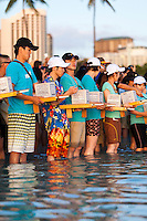On Memorial Day, Japanese participants stand in the water holding lanterns at the 15th Annual Lantern Floating Ceremony at Ala Moana Beach Park, Honolulu, O'ahu.