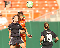 Sonia Bompastor #8 of Washington Freedom goes for a header with Yael Averbuch #10 of Sky Blue FC during a WPS match at RFK Stadium on May 23, 2009 in Washington D.C.