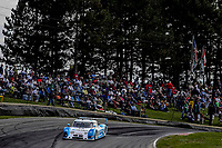 LEXINGTON, OH - SEPTEMBER 17:  The #01 BMW Riley of Scott Pruett and memo Rojas races past a hillside of fans during the EMCO Gears Classic at Mid-Ohio Sports Car Course on September 17, 2011 in Lexington, Ohio.  (Photo by Brian Cleary/bcpix.com)