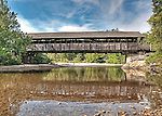 Covered bridge in Waitsfield, Vermont, built in 1833 (side view from the stream below).