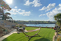 BNPS.co.uk (01202) 558833. <br /> Pic: LillicrapChilcott/BNPS<br /> <br /> An impressive waterfront home with panoramic views over one of Britain's most popular estuaries is on the market for £2.75m.<br /> <br /> Tregytreath is the perfect property for boat lovers, with access to the foreshore and its own private jetty onto the water.<br /> <br /> The five-bedroom house is in Restronguet Point, one of the most exclusive waterside locations in Cornwall, and this property has one of the most outstanding positions among those prestigious homes.<br /> <br /> The house was designed and built, by the current owners 20 years ago, to make the most of the beautiful views.