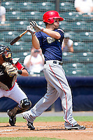 Bryce Harper #34 of the Harrisburg Senators follows through on his swing against the Richmond Flying Squirrels at The Diamond on July 22, 2011 in Richmond, Virginia.  The Squirrels defeated the Senators 5-1.   (Brian Westerholt / Four Seam Images)