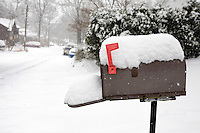 A mailbox covered with snow during winter.