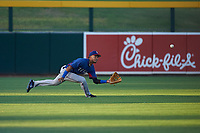 AZL Rangers left fielder William Jeffry (12) makes a diving catch during an Arizona League game against the AZL Athletics Gold on July 15, 2019 at Hohokam Stadium in Mesa, Arizona. The AZL Athletics Gold defeated the AZL Rangers 9-8 in 11 innings. (Zachary Lucy/Four Seam Images)