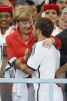 Chancellor of Germany Angela Merkel hugs Mario Gotze of Germany