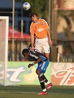 Houston's Eddie Robinson heads the ball over Earthquakes Kei Kamara,.San Jose Earthquakes over the Houston Dynamo 2-1, at Buck Shaw Stadium in Santa Clara, Calif., Thursday, May 22, 2008. .
