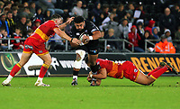 Ma'afu Tia of the Ospreys (C) is brought down by Elliot Dee (L) and Leon Brown of the Dragons (R) during the Guinness PRO14 match between Ospreys and Dragons at The Liberty Stadium, Swansea, Wales, UK. Friday 27 October 2017