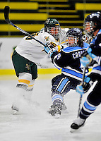 23 November 2011: University of Vermont Catamount forward Meghan Huertas, a Freshman from Boynton Beach, FL, collides with University of Maine Black Bear forward Myriam Croussette, a Senior from Baie-Comeau, Quebec at Gutterson Fieldhouse in Burlington, Vermont. The Lady Bears defeated the Lady Cats 5-2 in Hockey East play. Mandatory Credit: Ed Wolfstein Photo