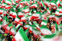 Thousands of schoolgirls and members of the women's Bassiz religious paramilitary wave the Iranian flag on the thirtieth anniversary of the Islamic Revolution in Tehran's central Azadi Square.