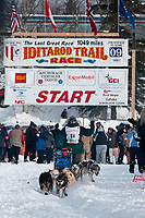 Jeff Holt team leaves the start line during the restart day of Iditarod 2009 in Willow, Alaska