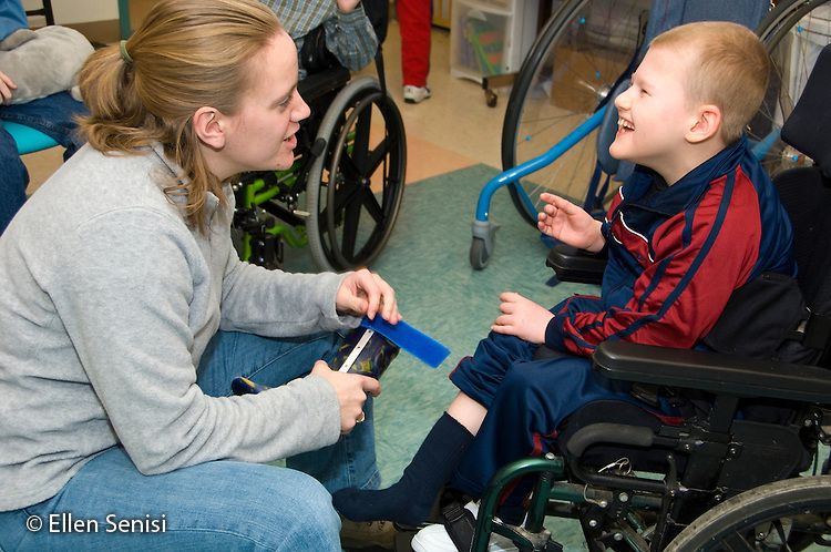 MR / Albany, NY.Langan School at Center for Disability Services .Ungraded private school which serves individuals with multiple disabilities.Teacher and child interact and laugh at arrival time, while putting on his AFO's (Ankle foot orthotics). Boy: 9, cerebral palsy, non verbal with expressive and receptive language delays.MR: Law4; Ris4.© Ellen B. Senisi