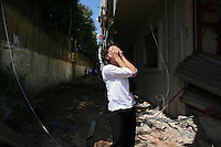 Beirut, Lebanon, Aug 14 2006.A woman discovers her home is totally gone, levelled beyond recognition by the Israeli bombs. Mere hours after the beginning of the cease-fire, thousands of inhabitants return to Hareit Hreik, the main Hezbollah stronghold in the capital, constantly targeted by Israeli air force bombing raids during 33 days and almost totally destroyed as a result.