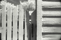 Corner of house and wooden fence<br />