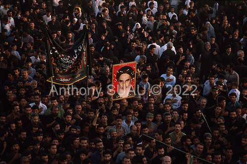 """Tehran, Iran .June 9, 1989..Hundreds of thousands of mourners visit at the grave site for the Grand Ayatullah Sayid Ruhullah Musawi Khomeini in the Beheht-E-Zahra cemetery. He died of heart attack on June 3, 1989...Khomeini was a senior Shi`i Muslim cleric, Islamic philosopher and marja (religious authority), and the political leader of the 1979 Iranian Revolution that saw the overthrow of Mohammad Reza Pahlavi, the last Shah of Iran. Following the revolution, Khomeini became the country's Supreme Leader?the paramount political figure of the new Islamic Republic...Khomeini was a marja al-taqlid, (source of imitation) and important spiritual leader to many Shia Muslims. He was also an innovative Islamic political theorist, most noted for his development of the theory of velayat-e faqih, the """"guardianship of the jurisconsult (clerical authority)"""". He was named Time's Man of the Year in 1979 and also one of Time magazine's 100 most influential people of the 20th century."""