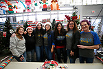 Images from the 15th annual Holiday with a Hero program at Walmart in Carson City, on Wednesday, Dec. 19, 2018. The program, which pairs local heroes with more than 200 K-8th graders, provides a $100 Christmas shopping spree at Walmart.  <br /> Photo by Cathleen Allison/Nevada Momentum
