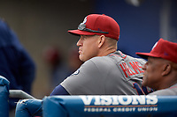 Lehigh Valley IronPigs bench coach Wes Helms (18) in the dugout during a game against the Syracuse Chiefs on May 20, 2018 at NBT Bank Stadium in Syracuse, New York.  Lehigh Valley defeated Syracuse 5-2.  (Mike Janes/Four Seam Images)