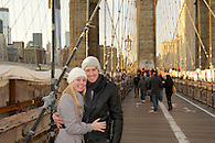 The happy couple posing on The Brooklyn Bridge right after she accepted.