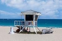 Ft. Lauderdale, Florida.  Beach Scene.  Lifeguard Shack, Parasailer in Background.