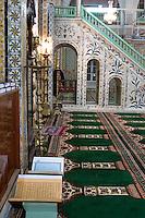 Tripoli, Libya - Gurgi Mosque, Tripoli Medina, showing minbar (pulpit).  Tunisian Tiles.   Floral stonecarving by Moroccan artisans.   Open Korans.  19th. century.  Last Tripoli mosque built during Turkish rule.
