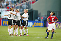 Tiffeny Milbrett, right, ponders a 3-0 loss to Germany in the semi-finals of the 2003 WWC.