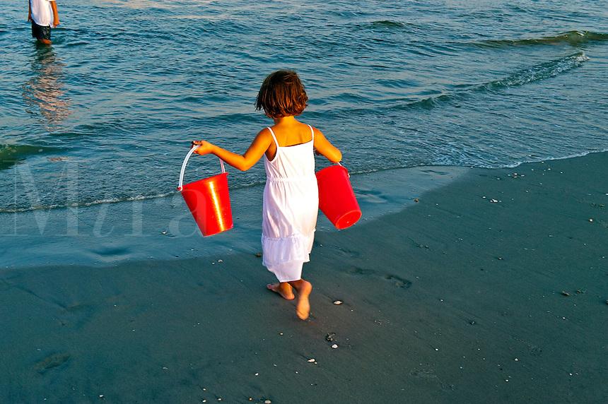 Girl plying in ocean.