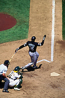 OAKLAND, CA - Frank Thomas of the Chicago White Sox bats during a game against the Oakland Athletics at the Oakland Coliseum in Oakland, California on August 10, 1994. Photo by Brad Mangin