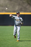 Grant Williams (11) of the Kennesaw State Owls warms up in the outfield prior to the game against the prior to the game against the Winthrop Eagles at the Winthrop Ballpark on March 15, 2015 in Rock Hill, South Carolina.  The Eagles defeated the Owls 11-4.  (Brian Westerholt/Four Seam Images)