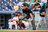 Nashville Sounds catcher Bruce Maxwell (36) and home plate umpire Junior Valentine await the pitch during a game against the New Orleans Baby Cakes on April 30, 2017 at First Tennessee Park in Nashville, Tennessee.  The game was postponed due to inclement weather in the fourth inning.  (Mike Janes/Four Seam Images)