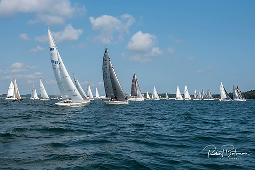 Yachts racing in the at home regattaassembleda second time for a starting gun opposite the Naval base. Initially proceedings got under way in light winds but a second race started off the no. 8 buoy in perfect sailing conditions.
