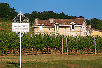 A white sign in the vineyard and the chateau of Chateau Pavie 1er premier first Grand Cru Classe Saint Emilion Bordeaux Gironde Aquitaine France