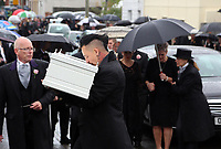 """COPY BY TOM BEDFORD<br /> Pictured: Paul Black kisses the white coffin of his daughter Pearl as he carries it to the Jerusalem Baptist Chapel in Merthyr Tydfil, Wales, UK. Friday 18 August 2017<br /> Re: The funeral of a toddler who died after a parked Range Rover's brakes failed and it hit a garden wall which fell on top of her will be held today at Jerusalem Baptist Chapel in Merthyr Tydfil.<br /> One year old Pearl Melody Black and her eight-month-old brother were taken to hospital after the incident in south Wales.<br /> Pearl's family, father Paul who is The Voice contestant and mum Gemma have said she was """"as bright as the stars""""."""