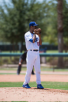 AZL Dodgers relief pitcher Edward Cuello (60) looks in for the sign during an Arizona League game against the AZL Padres 2 at Camelback Ranch on July 4, 2018 in Glendale, Arizona. The AZL Dodgers defeated the AZL Padres 2 9-8. (Zachary Lucy/Four Seam Images)