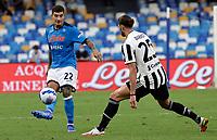 11th September 2021; Maradona Stadium, Naples, Italy; Serie A football, SSC Napoli versus Juventus  FC: Giovanni Di Lorenzo of Napoli passes accross the block from Rabiot of Juve