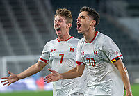 WASHINGTON, DC - SEPTEMBER 6: Maryland midfielder Brayon Padilla (70) after scoring the winning goal celebrates with forward Hunter George (7) during a game between University of Virginia and University of maryland at Audi Field on September 6, 2021 in Washington, DC.