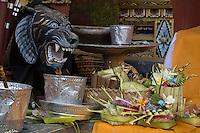 Jatiluwih, Bali, Indonesia.  Offerings (Canang) Placed before Temple Guardian, Luhur Bhujangga Waisnawa Hindu Temple.
