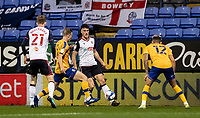 Bolton Wanderers' Ryan Delaney (centre) crosses under pressure <br /> <br /> Photographer Andrew Kearns/CameraSport<br /> <br /> The EFL Sky Bet League Two - Bolton Wanderers v Mansfield Town - Tuesday 3rd November 2020 - University of Bolton Stadium - Bolton<br /> <br /> World Copyright © 2020 CameraSport. All rights reserved. 43 Linden Ave. Countesthorpe. Leicester. England. LE8 5PG - Tel: +44 (0) 116 277 4147 - admin@camerasport.com - www.camerasport.com